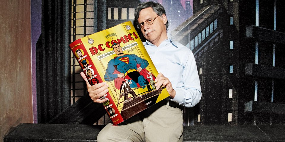 Taschen's pic of Paul Levitz having to sit down to hold that gigantic book.