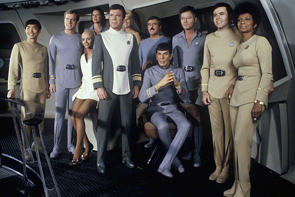 1979 --- Cast members on set of the 1979 film Star Trek: The Motion Picture include from left: George Takei, Stephen Collins, Persis Khambatta, Majel Barrett (in back), William Shatner, Grace Lee Whitney (in back), James Doohan, Leonard Nimoy, DeForest Kelley, Walter Koenig, and Nichelle Nichols. --- Image by © Steve Schapiro/Corbis