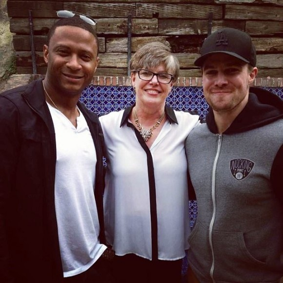 Stephen Amell posted this on Facebook on Sunday: That's his mom flanked by him and David Ramsey.