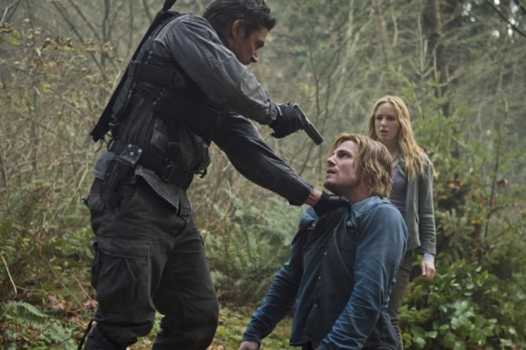 Slade (Manu Bennett) and Oliver in an Island flashback, with Sara (Caity Lotz). Cate Cameron/The CW