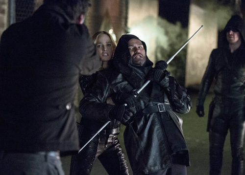 Paul Blackthorne as Quentin Lance, Caity Lotz as Canary, Shaker Peleja as the Assassin, and Stephen Amell as the Arrow -- Photo: Cate Cameron/The CW