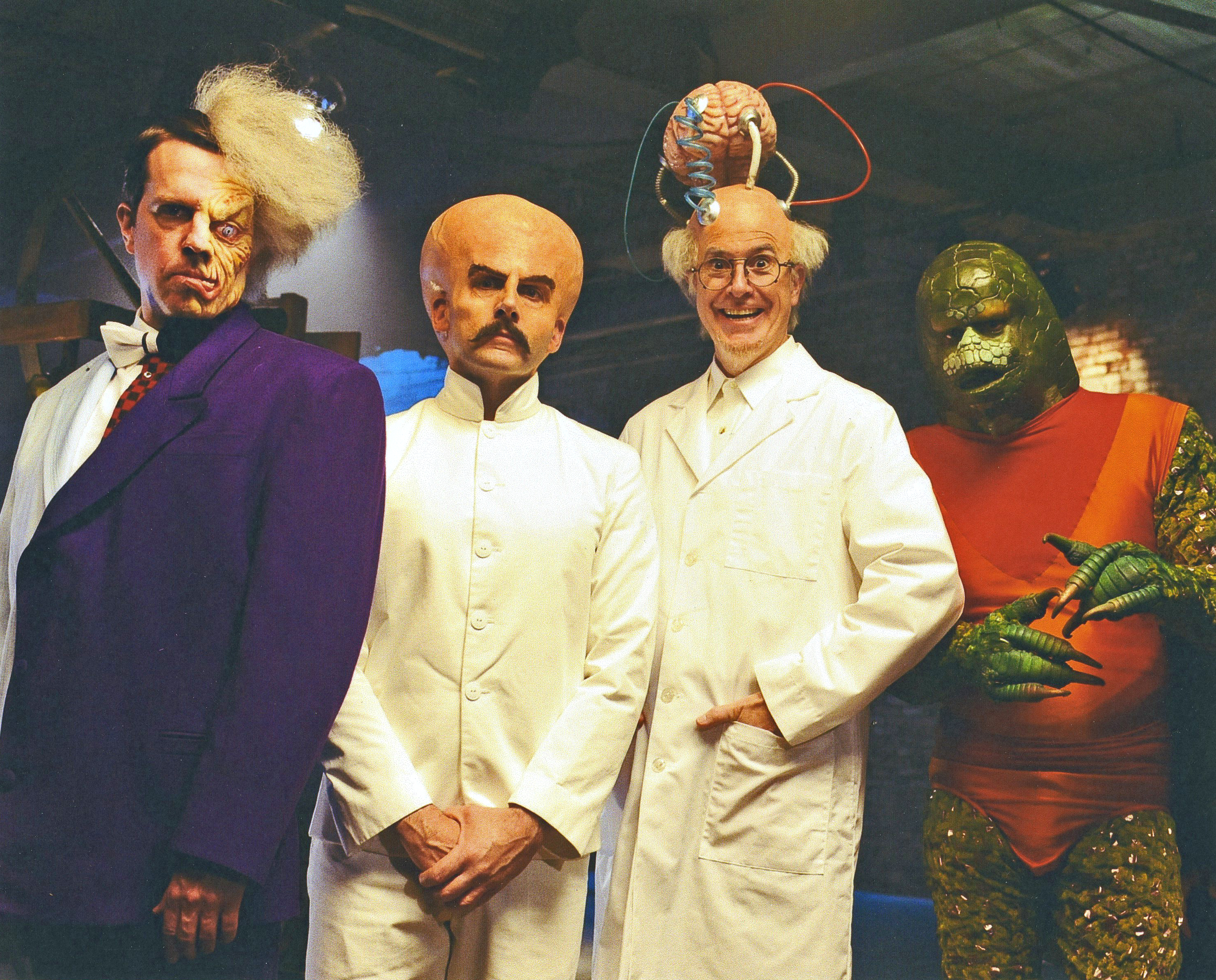 "Cast of live action villains from ""The Dark Clenched Hole Of Evil."" From left to right: Ed Helms/Half-Scary, Steve Carell/Bighead, Stephen Colbert/Dr. Brainio, and Fred Armisen/Lizardo. Courtesy Sedelmaier."