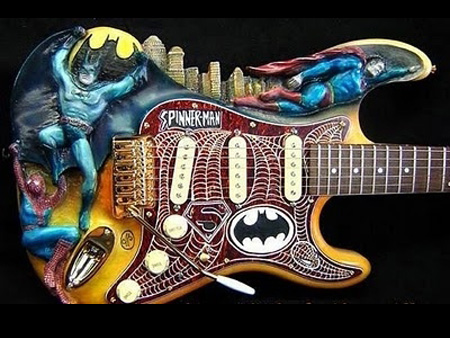 Batman, Superman, Spider-Man guitar. Check out the carved relief on this sucker.