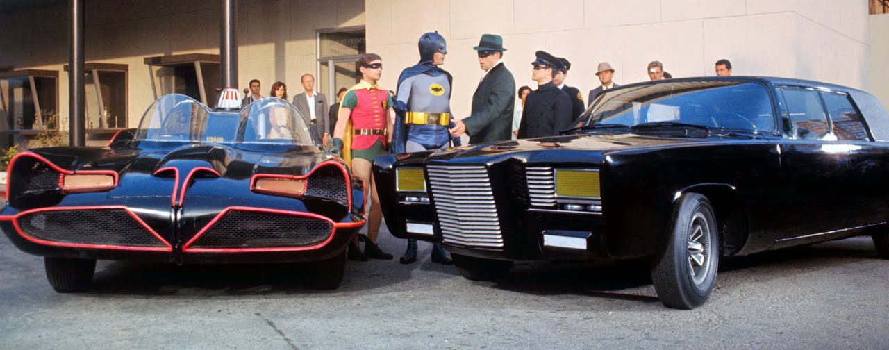 20 May 1966, Hollywood, Los Angeles, California, USA --- Holy moley and flaming fender benders, kids, this has to be the confrontation of the century! Batman, Robin, the Green Hornet and Kato meet on a corner in Gotham City during the filming of a documentary on ABC-TV's fall season productions. They are discussing the merits of the Batmobile (L) and Black Beauty, the super-cars for the superstar crimebusters. To those in the know in real life (left to right) Robin is Burt Ward; Batman is Adam West; The Green Hornet is Van Williams; and Kato is played by Bruce Lee.