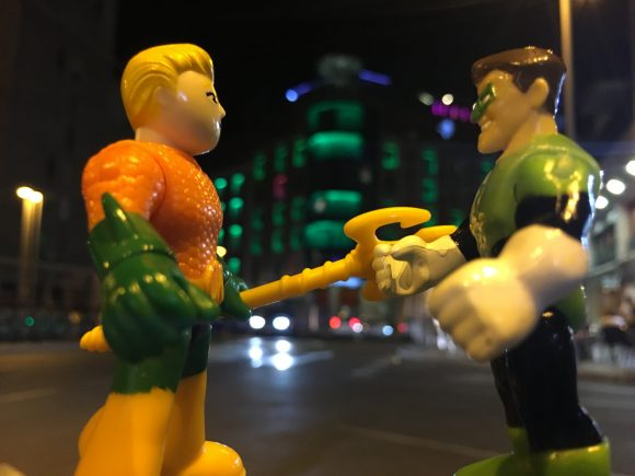 """That building's lights have turned green, Aquaman. That's my cue to take a spin around the sector. See you at the next meeting!"""